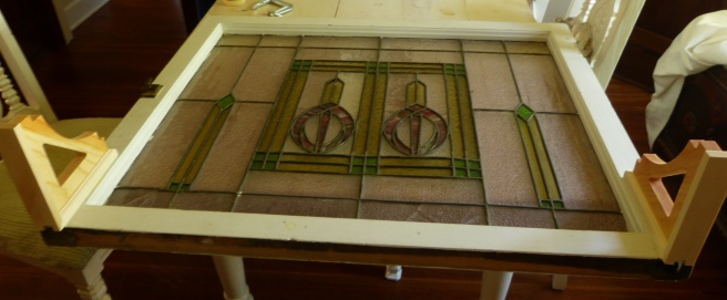 unpainted stained glass window with brackets