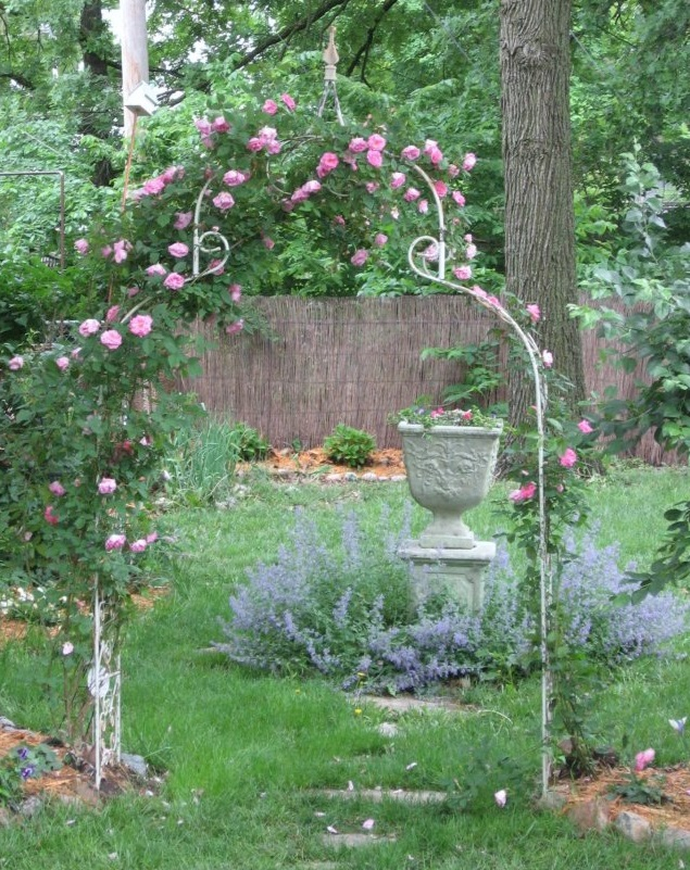 urn planter in middle of yard