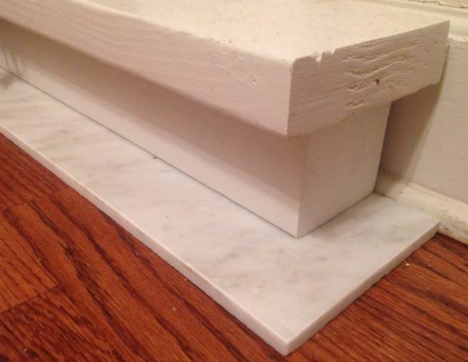 Hearth of a marble tile, a 4 x 4 post and 2 inch thick lumber